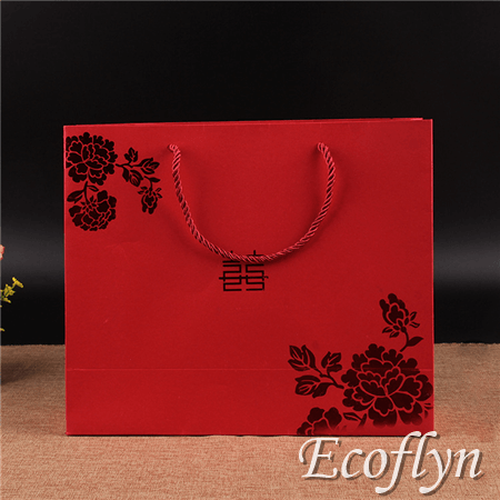 red paper bags with handles
