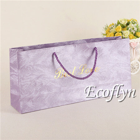 large purple gift bags