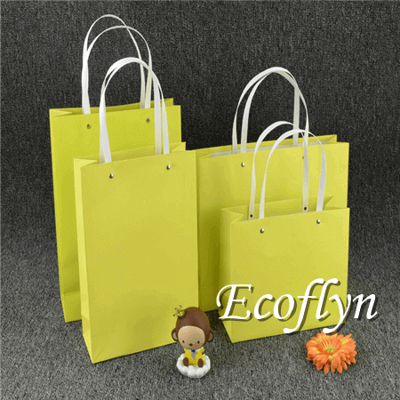 small yellow paper bags