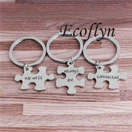 hot sale custom personalized jigsaw puzzle keychains silver puzzle piece keychain in bulk wholesale low minimum supply in China
